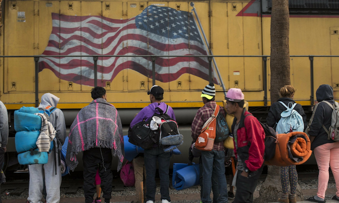 Central American migrants, part of the Central American caravan trying to reach the United States, continue their journey as  they leave Mexicali, Mexico, on Nov. 20, 2018. (AP Photo/Rodrigo Abd)