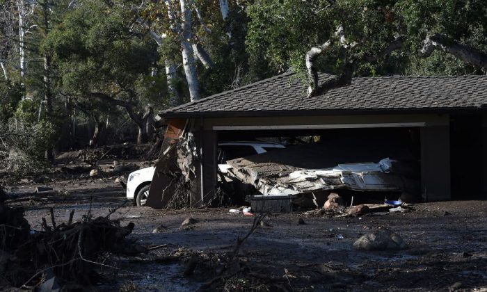 A home is surrounded by mud and debris caused by a massive mudflow in Montecito, Calif., on Jan. 10, 2018. (Robyn Beck/AFP/Getty Images)
