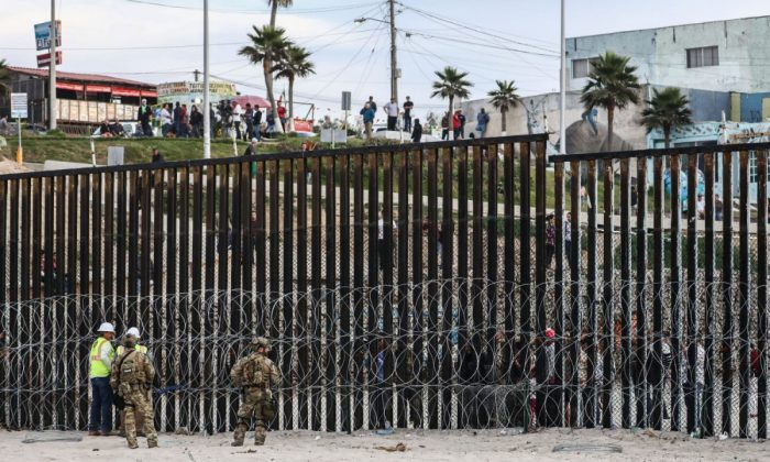 The U.S. military patrols the U.S.-Mexico border fence at Friendship Park in San Ysidro, Calif., on Nov. 15, 2018. (Charlotte Cuthbertson/The Epoch Times)