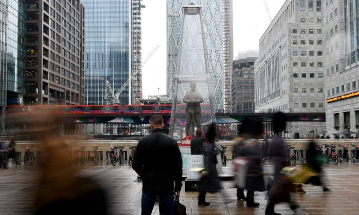 People walk past a temporary sculpture installed to mark the centenary of the Armistice which ended the First World War, in the Canary Wharf financial district of London, Britain on Nov. 1, 2018. (Toby Melville/Reuters)