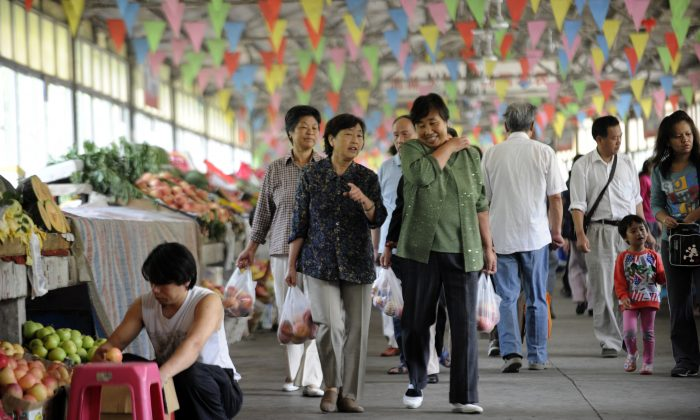 Residents make their way along a market in Beijing on Sept. 7, 2012. (Wang Zhao/AFP/GettyImages)