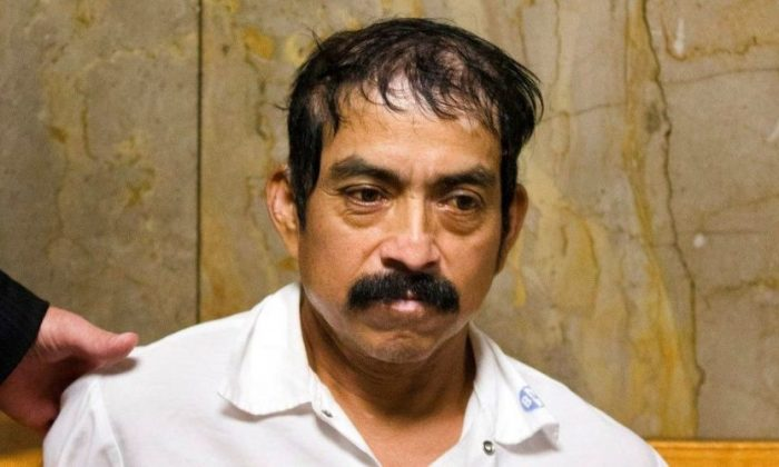 Conrado Juarez waits to be arraigned at Manhattan Criminal Court in New York on Oct. 12, 2013. Juarez died in custody on Nov. 18, 2018. (AP Photo/John Minchillo, File)