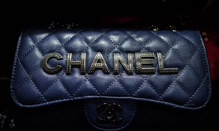 A Chanel counterfeit luxury bag is displayed during a press conference following a record seizure at the customs headquarters in Hong Kong on August 6, 2015. (Philippe Lopez/Getty Images)