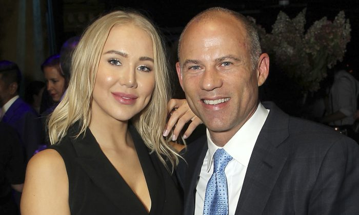 Attorney Michael Avenatti poses with Mareli Miniutti for a photo at a party in New York in September 2018. (Marion Curtis/StarPix via AP)