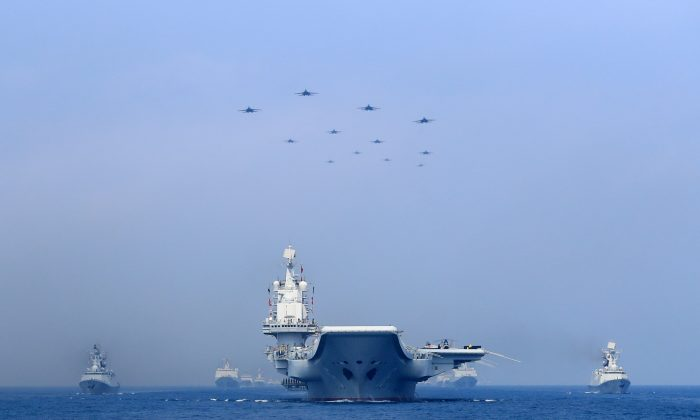Warships and fighter jets of Chinese People's Liberation Army (PLA) Navy take part in a military display in the South China Sea on April 12, 2018. (Reuters)