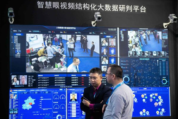 Visitors are filmed by artificial intelligence security cameras using facial recognition technology at an international security expo in China.