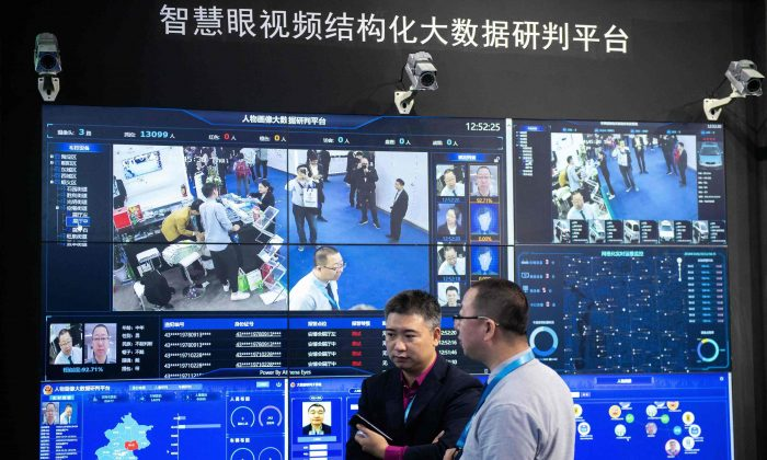 Visitors are filmed by artificial intelligence security cameras using facial recognition technology at an international security expo at the China International Exhibition Center in Beijing on Oct. 24, 2018. (Nicolas Asfouri/AFP/Getty Images)
