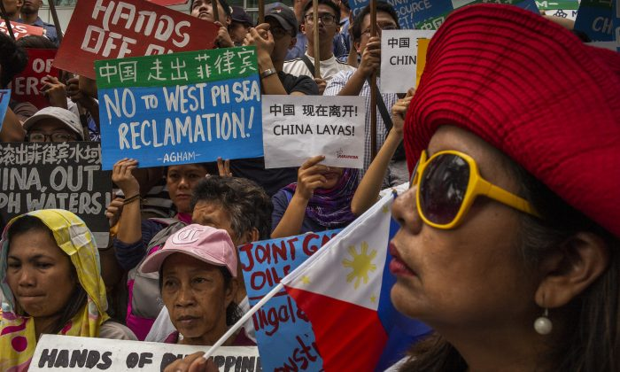 Protesters march on the street chanting and carrying anti-China slogans in the business district of Makati, Philippines on Nov. 30, 2018. (Jes Aznar/Getty Images)