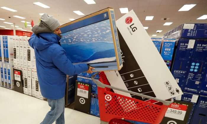 A customer loads his shopping cart during the Black Friday sales event on Thanksgiving Day at Target in Chicago, Illinois, on Nov. 24, 2016. (Kamil Krzaczynski   - S1AEUOTVCAAA/File Photo/Reuters)