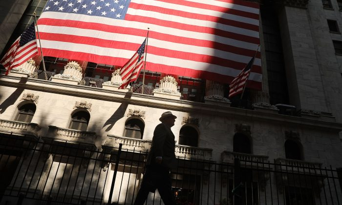 A man walks by the New York Stock Exchange (NYSE) in New York, in this file photo. The economy has done well for everybody after Donald Trump's election but faces headwins with a gridlocked Congress. (Spencer Platt/Getty Images)