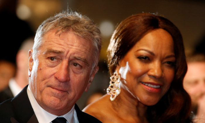 Robert De Niro and his wife Grace Hightower pose on the red carpet at the 69th Cannes Film Festival in France, May 16, 2016. (Eric Gaillard/Reuters)