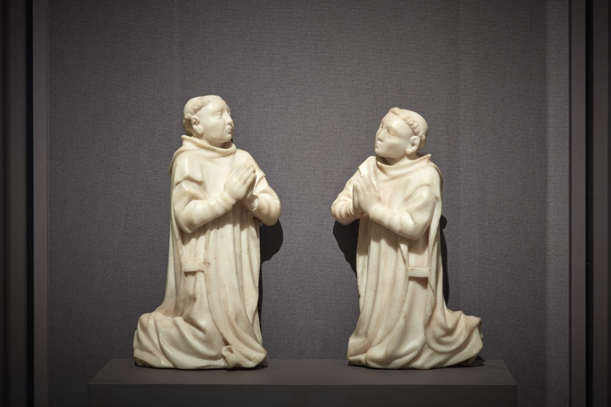 """Kneeling Carthusian Monks,"" circa 1380–1400, by unknown artist from Burgundy. Marble, (L) 10 1/16 inches by 5 1/2 by 2 5/8 inches; (R) 9 1/2 inches by 5 3/4 inches by 2 15/16 inches, The Cleveland Museum of Art. (Courtesy of The Frick Collection)"