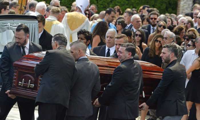 In this Aug. 6, 2016 file photo, mourners carry the casket of Karina Vetrano from St. Helen's Church following her funeral in the Howard Beach section of the Queens borough of New York. (Steven Sunshine/Newsday via AP, File)