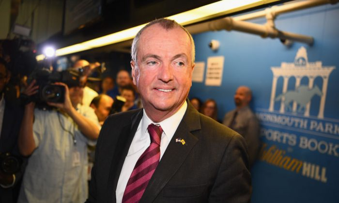 The governor of New Jersey, Phil Murphy places the first bet at the William Hill Sports Book at Monmouth Park on June 14, 2018 in Oceanport, N.J. (Kotinsky/Getty Images for William Hill Race & Sports Bar )