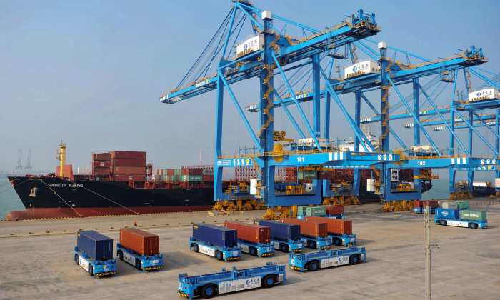This photo taken on Oct. 24, 2018, shows driverless trucks transferring containers at an automated cargo wharf in Qingdao in China's eastern Shandong province. (STR/AFP/Getty Images)
