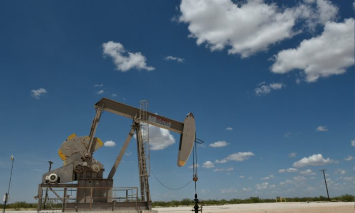 A pump jack operates in the Permian Basin oil production area near Wink, Texas on Aug. 22, 2018.  (Nick Oxford/Reuters)