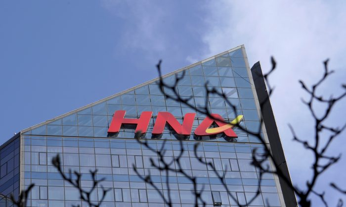A HNA Group logo is seen on the building of HNA Plaza in Beijing on Feb. 9, 2018. (Jason Lee/Reuters)
