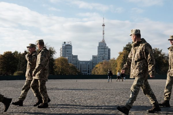Ukrainian soldiers walk through the central square of Kharkiv ahead of Defender of Ukraine Day in October.