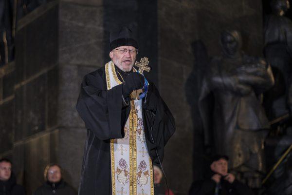 Viktor Marynchak, a Ukrainian Orthodox priest, addresses people gathered in Kharkiv, Ukraine.