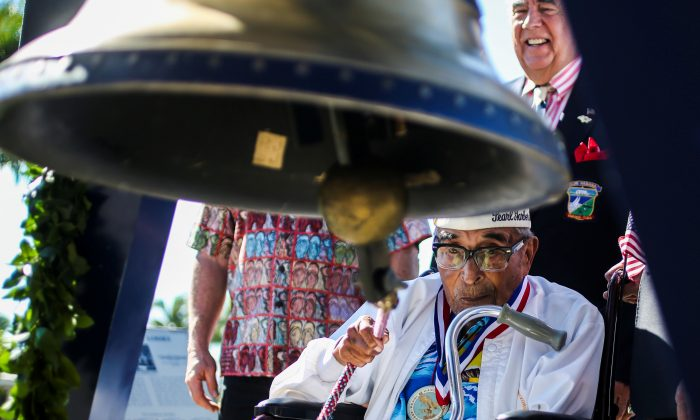 Ray Chavez, 104, the oldest living Pearl Harbor survivor, rings the Freedom Bell during the Freedom Bell Opening Ceremony and Bell Ringing at the USS Bowfin Submarine Museum & Park on Pearl Harbor, Hawaii, on Dec. 6, 2016. (Wesley Timm/Handout/Reuters)