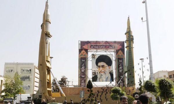 Supreme Leader Ayatollah Ali Khamenei with missiles