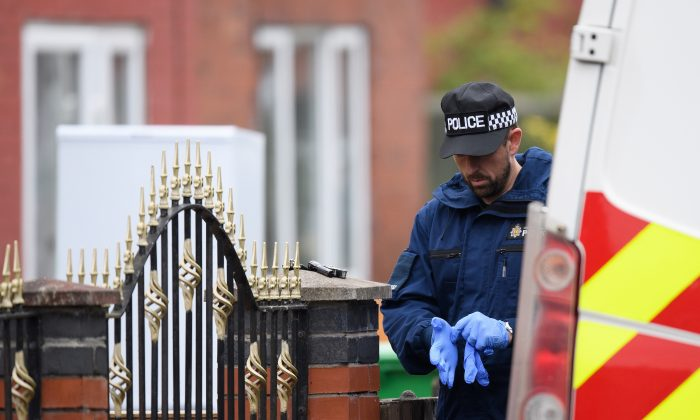 A policeman outside the  former home of terrorist Salman Abedi on May 24, 2017 in Manchester, England. (Leon Neal/Getty Images)