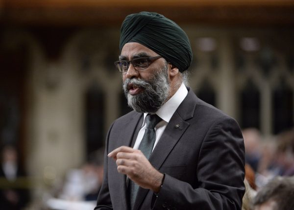 Sajjan is seen answering questions