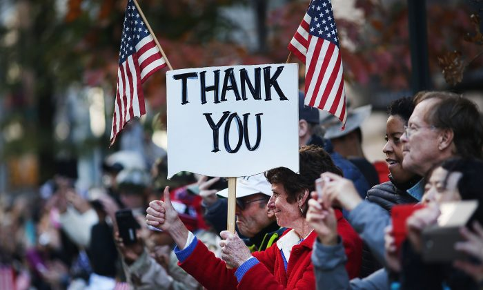 In this file photo, people show their support to veterans during the Veterans Day Parade in New York City on Nov. 11, 2016. (Spencer Platt/Getty Images)