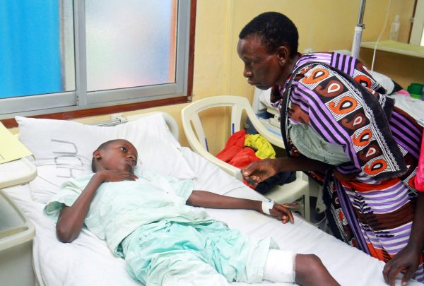 A woman talks to a child injured when Italian charity work Silvia Romano was seized in the coastal Kilifi county in Kenya.
