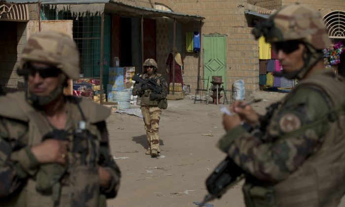 French soldiers patrol through the central market in Timbuktu, Mali. (AP Photo/Rebecca Blackwell, File)