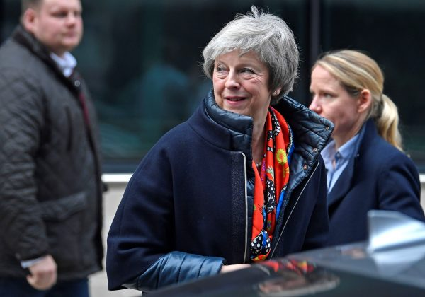 Britain's Prime Minister Theresa May leaves the BBC, after taking part in a live radio phone-in, in central London