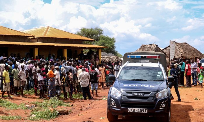 Villagers gather beside a police vehicle as they look at an area where a grenade exploded during an attack by a gang in the coastal Kilifi county, south-east Kenya, on Nov. 21, 2018, during which Silvia Romano, an Italian charity worker was abducted. (Stringer/AFP/Getty Images)