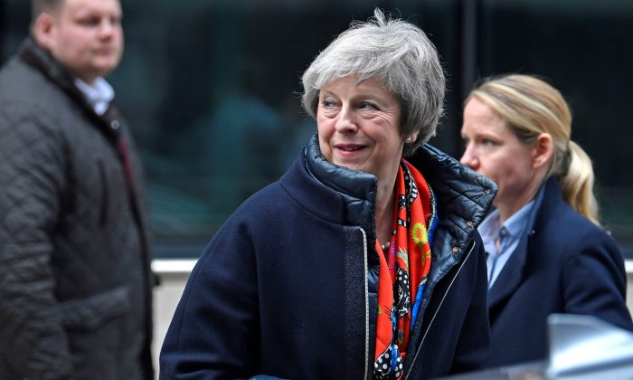 Britain's Prime Minister Theresa May leaves the BBC, after taking part in a live radio phone-in, in central London, Britain, on Nov. 23, 2018. (Toby Melville/Reuters)