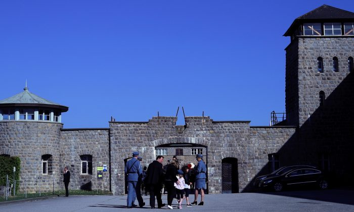 People arrive at the memorial site of the former concentration camp Mauthausen ahead of the commemoration ceremony of liberation, Mauthausen, Austria, on May 6, 2018. (Lisi Niesner/Reuters)