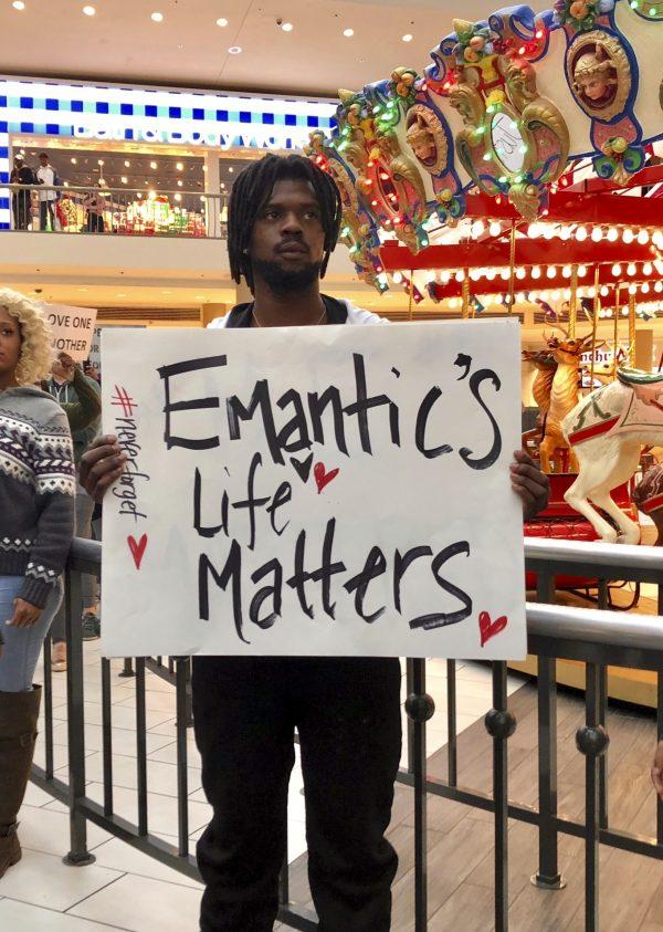 Elijah King holds a sign