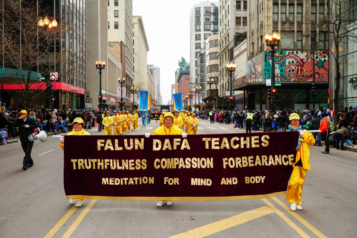 Falun Gong hold a banner
