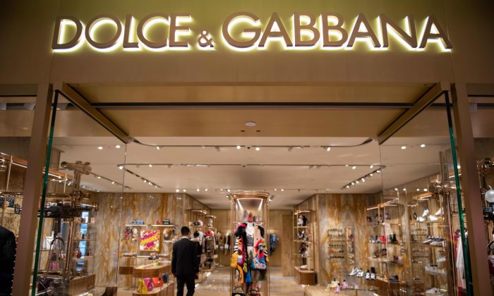 A man walks inside a Dolce & Gabbana shop in Beijing on November 22, 2018. Dolce & Gabbana cancelled a long-planned fashion show in Shanghai on November 21 after an outcry over racially offensive posts on its social media accounts. (NICOLAS ASFOURI/AFP/Getty Images)