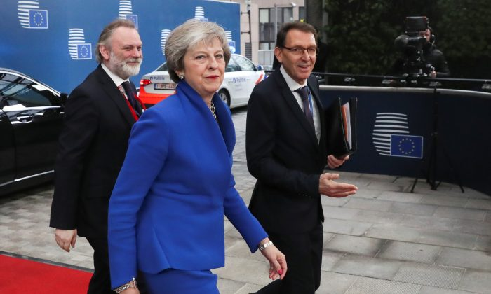 Britain's Prime Minister Theresa May arrives with Britain's Permanent Representative to the EU Tim Barrow at an extraordinary EU leaders summit to finalise and formalise the Brexit agreement in Brussels, Belgium, on Nov. 25, 2018. (Yves Herman/Pool/Reuters)