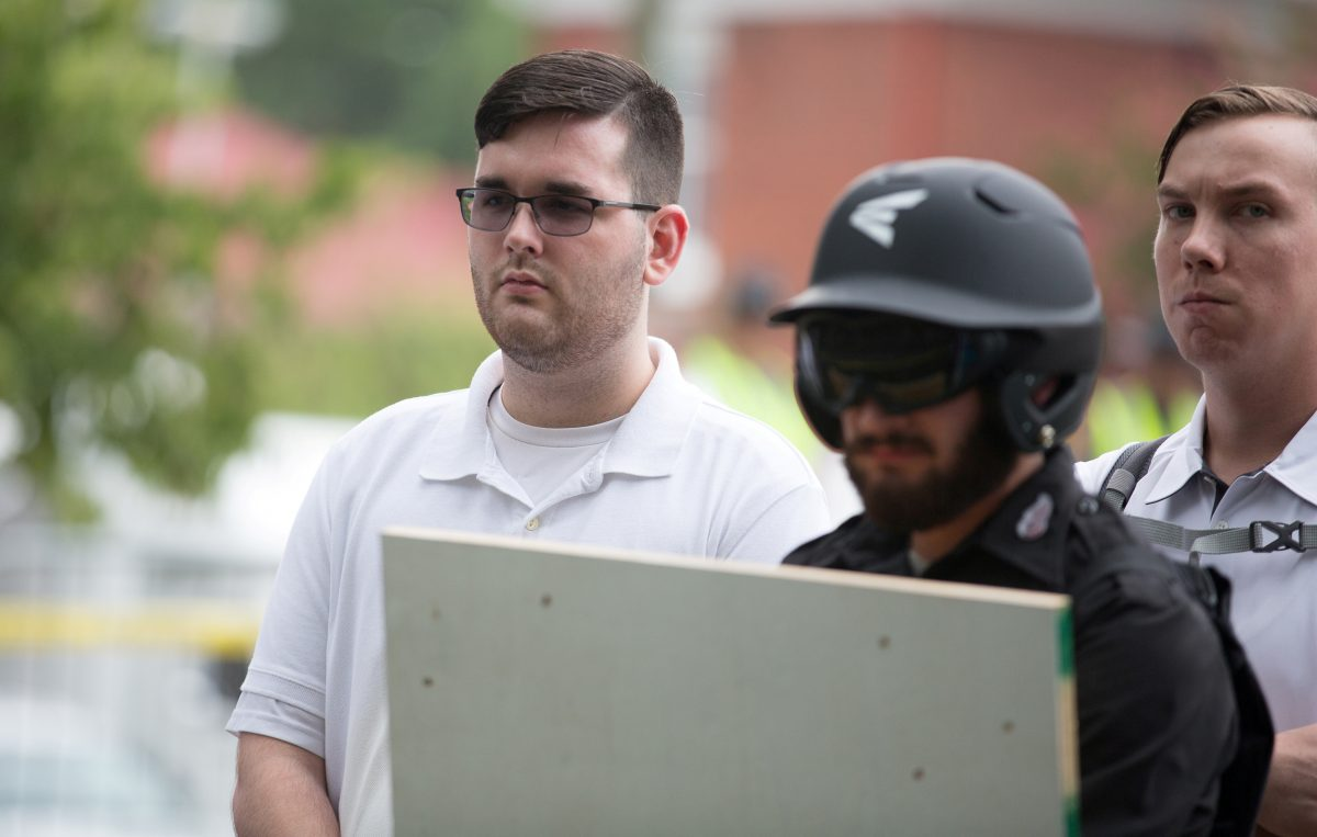 James Alex Fields Jr., (L) is seen attending the rally in Emancipation Park before being arrested by police in Charlottesville