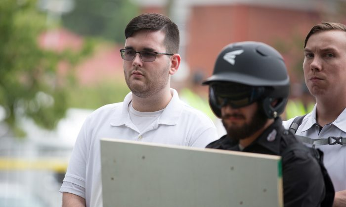 James Alex Fields Jr., (L) is seen attending the rally in Emancipation Park before being arrested by police in Charlottesville, Va., on Aug. 12, 2017. (Reuters/Eze Amos/File Photo)