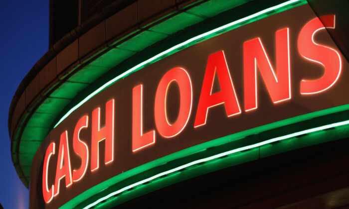 A sign outside a 'Speedy Cash' cash loans shop in London, England, on Nov. 1, 2012. (Dan Kitwood/Getty Images)