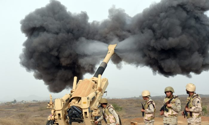 Saudi army artillery fires shells towards Yemen from a post close to the Saudi-Yemeni border, in southwestern Saudi Arabia, on April 13, 2015 . (FAYEZ NURELDINE/AFP/Getty Images)