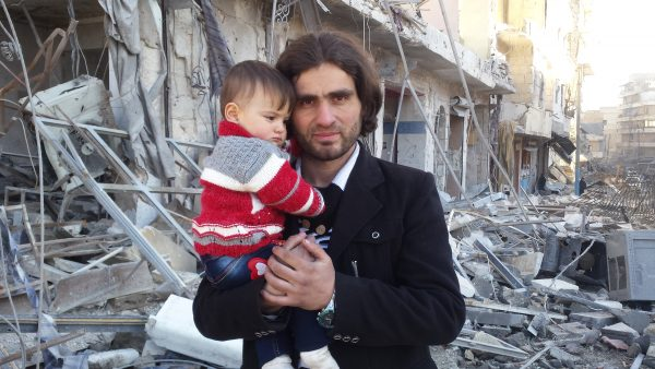 Abdulkafi Alhamdo with his daughter when they and hundreds of others were evacuated from Aleppo in December 2016.
