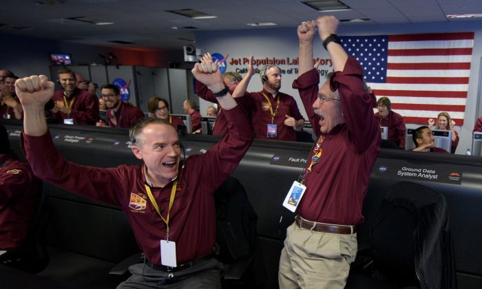 Mars InSight team members Kris Bruvold and Sandy Krasner react after receiving confirmation that the Mars InSight lander successfully touched down on the surface of Mars, in Pasadena, California, U.S. November 26, 2018.   NASA/Bill Ingalls/Handout via REUTERS