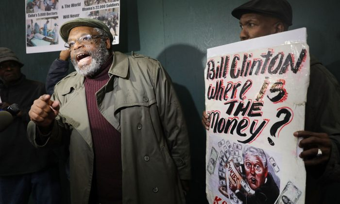 Haitian activists protest in front of the Clinton Foundation on the eighth anniversary of the Haitian earthquake, in New York City, on Jan. 12, 2018. (Spencer Platt/Getty Images)
