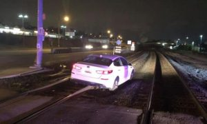 Woman Claims 'GPS Told Me to Do It' After Driving on Railroad Tracks, Police Say