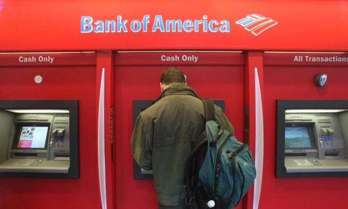 man stands at a Bank of America ATM