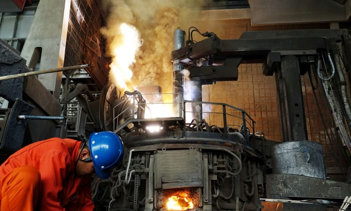 A man works in front of a furnace at a steel plant of Dalian Special Steel Co Ltd. in Dalian, Liaoning Province, China on June 20, 2018. (Reuters)