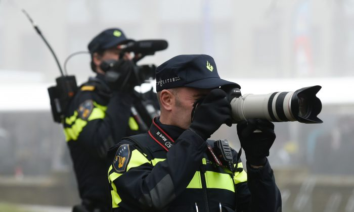Dutch Policeman take pictures of the supporters of Dutch far-right Freedom Party leader (Partij Voor De Vrijheid - PVV) Geert Wilders as he officially launches his parliamentary election campaign in Spijkenisse on February 18, 2017.(JOHN THYS/AFP/Getty Images)
