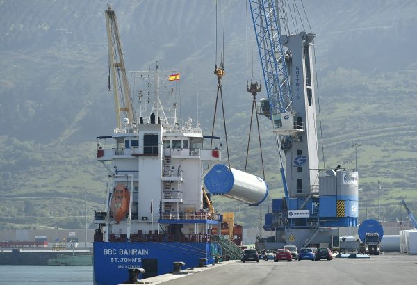Wind turbine towers are loaded onto a ship in Bilbao, Spain.